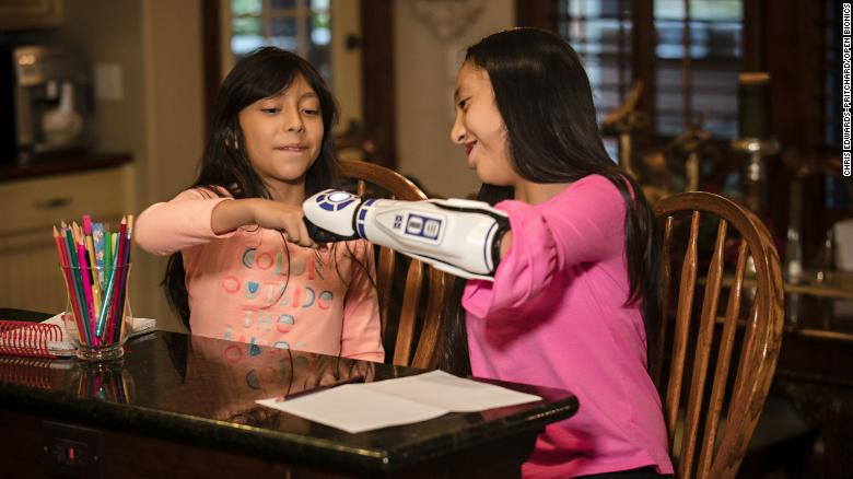 An 11-year-old 'Star Wars' fan got an R2-D2 bionic arm. Mark Hamill called her a hero